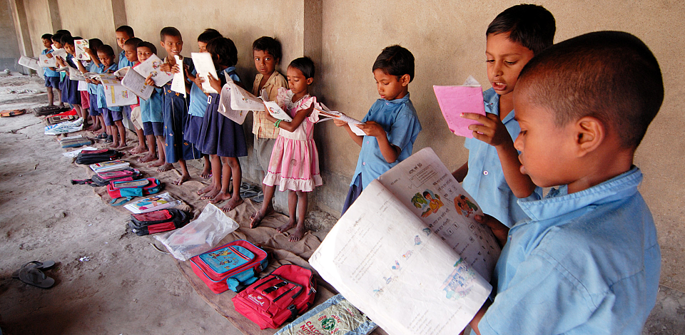 young students reading their textbooks